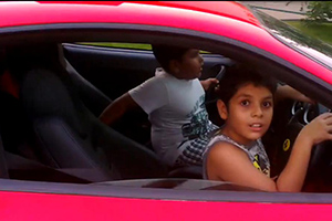 Kids driving a Ferrari